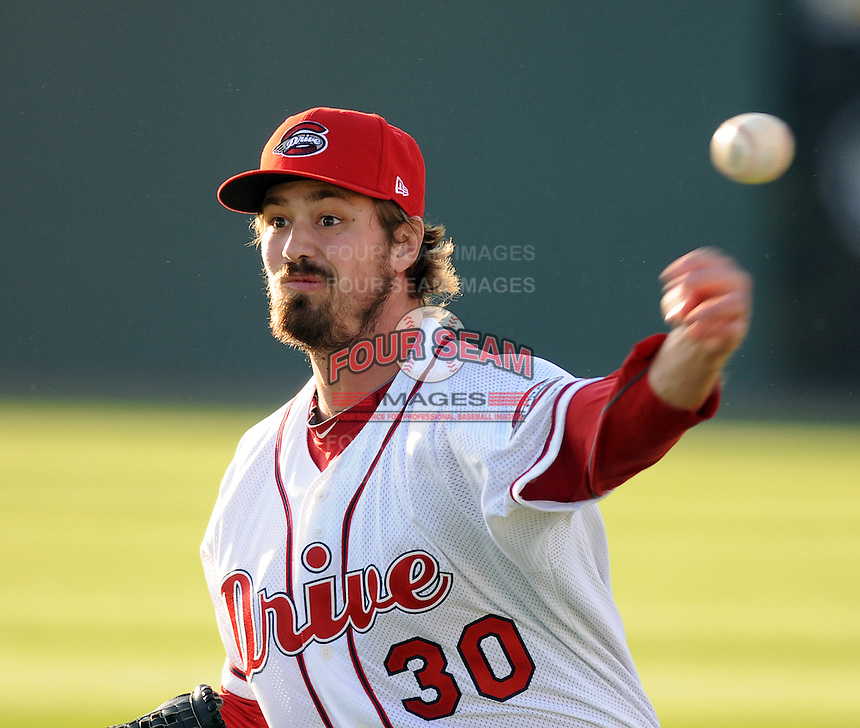 Starting pitcher Andrew Miller (30) of the Boston Red Sox, on a Major League rehab assignment with the Greenville Drive, pitches in a game against the Hickory Crawdads on April 9, 2012, at Fluor Field at the West End in Greenville, South Carolina. (Tom Priddy/Four Seam Images)