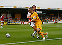 Chris Holroyd of Cambridge United finds his path blocked by Ashley Westwood of Wrexham during the Blue Square Premier match between Cambridge United and Wrexham at the Abbey Stadium, Cambridge on 19th September, 2009..© Kevin Coleman 2009 .