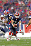 Buffalo Bills quaterback J.P. Losman (7) tosses a handoff to runningback Shaud Williams (20) in a play against the visiting New England Patriots at Ralph Wilson Stadium in Orchard Park, NY, on December 11, 2005 . The Patriots defeated the Bills 35-7. Mandatory Photo Credit: Ed Wolfstein