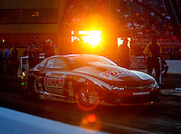 Jul 8, 2016; Joliet, IL, USA; The sun shines on NHRA pro stock driver Greg Anderson as he launches off the starting line during qualifying for the Route 66 Nationals at Route 66 Raceway. Mandatory Credit: Mark J. Rebilas-USA TODAY Sports