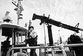"San Francisco, California.USA.March 19, 2003..The San Francisco Coast Guard patrols the bay near the city and the Golden Gate bridge. The US raises the terrorist alert to level ""Orange"" as it begins its war against Iraq."