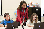 November 15, 2011. Mooresville, NC.. Ms. Thompson helps Spring Galles, right, and Ashton Crooks, 4th graders at East Mooresville Intermediate School, with math tutorials on their school issued laptops. Much of the class consists of computer based exercises which allows the teacher to help students individually.. The Mooresville school system has become nationally known for being on the cutting edge of using technology as an educational tool. Starting in 3rd grade, each student is issued their own laptop that they will use in class and at home to further their learning.