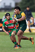 Sione Fifita makes a strong run past Alamoti Funaki. Counties Manukau Premier Club rugby game between Pukekohe and Waiuku, played at Colin Lawrie Fields, Pukekohe on Saturday April 14th, 2018. Pukekohe won the game 35 - 19 after leading 9 - 7 at halftime.<br /> Pukekohe Mitre 10 Mega -Joshua Baverstock, Sione Fifita 3 tries, Cody White 3 conversions, Cody White 3 penalties.<br /> Waiuku Brian James Contracting - Lemeki Tulele, Nathan Millar, Tevta Halafihi tries,  Christian Walker 2 conversions.<br /> Photo by Richard Spranger