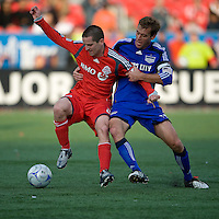 26 April 2009: Kansas City Wizards defender Jimmy Conrad #12 and Toronto FC midfielder Sam Cronin #2 in action during an MLS game at BMO Field between Kansas City Wizards and Toronto FC.Toronto FC won 1-0. .
