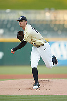 Wake Forest Demon Deacons starting pitcher Carter Bach (18) follows through on his delivery against the Charlotte 49ers at BB&T BallPark on March 13, 2018 in Charlotte, North Carolina.  The 49ers defeated the Demon Deacons 13-1.  (Brian Westerholt/Four Seam Images)