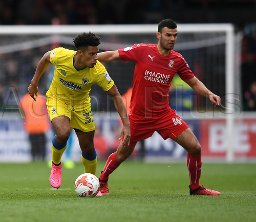 April 14th 2017, County Ground, Swindon, Wiltshire; Skybet league 1 football, Swindon Town versus AFC Wimbledon; Lyle Taylor, forward of AFC Wimbledon goes past Conor Thomas, midfielder for Swindon Town