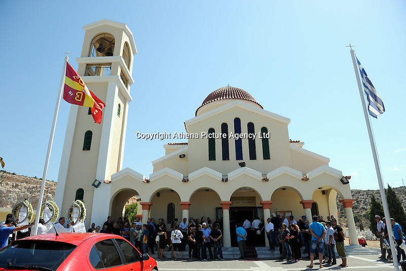 Pictured: People gather for the funeral service at a church in Schisto, Piraeus, Greece Friday 19 August 2016<br /> Re: The funeral for Theodosis Katifes and his five year old daughter Sevasti, two of the victims of a crash involving a speed boat and a ltourist boat has taken place at the Schisto area of Piraeus.<br /> Tharsivoulos Lykourezos, the captain of a speedboat that collided with a tourist boat off the Greek island of Aegina, killing four people, has appeared in court.<br /> The speedboat called Duente collided with a tourist boat called Antonia carrying more than 20 people.