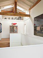 The upper floor has a pitched beamed roof with skylights which gives the space a light airy feel.