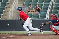 Alex Call (2) of the Kannapolis Intimidators lays down a bunt against the Lakewood BlueClaws at Kannapolis Intimidators Stadium on August 11, 2016 in Kannapolis, North Carolina.  The Intimidators defeated the BlueClaws 3-1.  (Brian Westerholt/Four Seam Images)