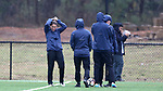 RALEIGH, NC - MARCH 13: Team captain Abby Erceg (NZL) (left) and teammates cover up in the cold driving rain. The North Carolina Courage held their first ever training session on March 13, 2017, at WRAL Soccer Center in Raleigh, NC to start their preseason before the 2017 NWSL Season. Prior to its offseason relocation the team was known as the Western New York Flash.