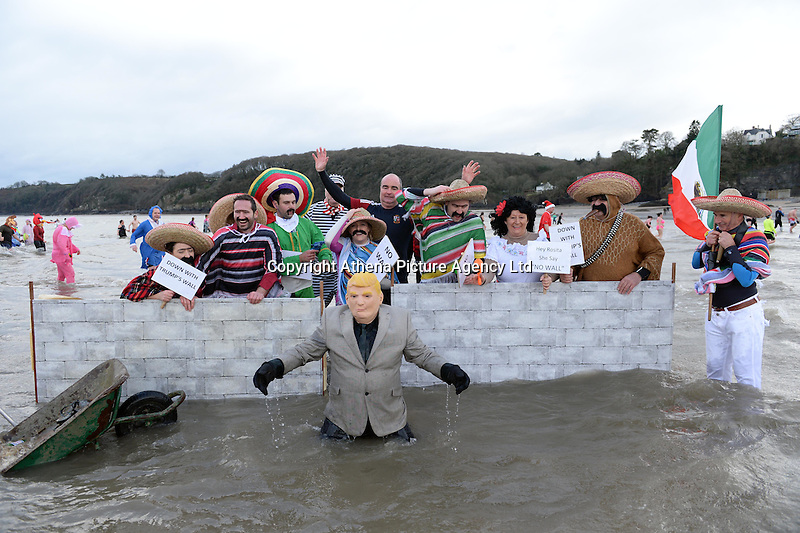 Hundreds of people in fancy dress take part in this year's New Year Swim in Saundersfoot, Pembrokeshire, Wales. Sunday 01 January 2017
