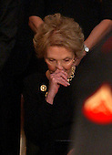 Washington, D.C. - June 9, 2004 -- Former first lady Nancy Reagan sheds a tear during the funeral service for her husband, former United States President Ronald Reagan in the rotunda of the United States Capitol in Washington, D.C. on June 9, 2004.<br /> Credit: Ron Sachs / CNP