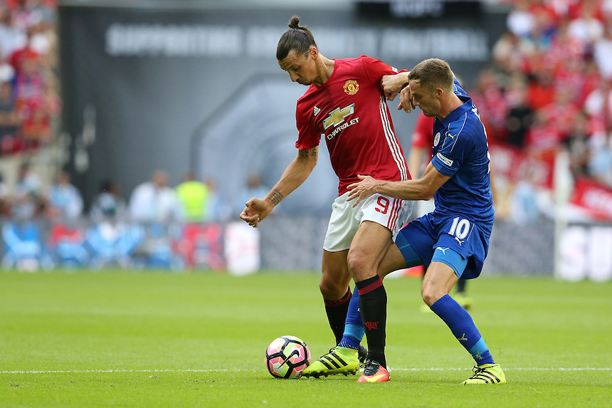 Manchester United's Zlatan Ibrahimovic shields the ball from Leicester City's Andy King<br /> <br /> Photographer Stephen White/CameraSport<br /> <br /> Football - The FA Community Shield - Leicester City v Manchester United - Sunday 7 August 2016 - Wembley Stadium - London<br /> <br /> World Copyright &copy; 2016 CameraSport. All rights reserved. 43 Linden Ave. Countesthorpe. Leicester. England. LE8 5PG - Tel: +44 (0) 116 277 4147 - admin@camerasport.com - www.camerasport.com