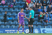 Craig Tanner of Plymouth Argyle receives a yellow card for a challenge on Luke O'Nien of Wycombe Wanderers during the Sky Bet League 2 match between Wycombe Wanderers and Plymouth Argyle at Adams Park, High Wycombe, England on 12 September 2015. Photo by Andy Rowland.