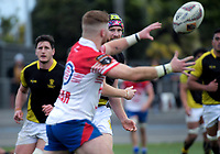Luke McMahon (left) intercepts a pass during the preseason provincial rugby match between Horowhenua Kapiti and Wellington at Levin Domain in Levin, New Zealand on Monday, 4 May 2018. Photo: Dave Lintott / lintottphoto.co.nz