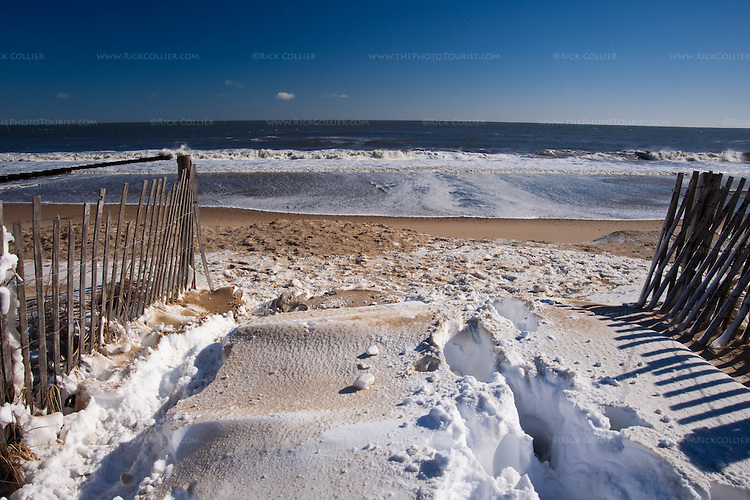 Snow drifts on the beach, dunes, and boardwalks create an unusually bright and striking scene along the beach at Rehoboth Beach, Delaware, the morning after the blizzard of February 2010.