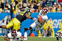January 01, 2011:    Mississippi State Bulldogs running back Vick Ballard (28) is tripped up by Michigan Wolverines linebacker J.B. Fitzgerald (42)during first half action during the Progressive Gator Bowl action between the Mississippi State Bulldogs and the Michigan Wolverines at EverBank Field in Jacksonville, Florida.
