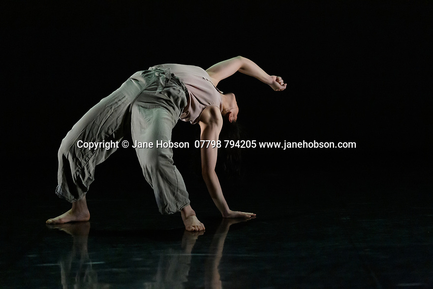 """Leeds, UK. 03.12.2019. Second Year students of BA (Hons) Dance (Contemporary), at the Northern School of Contemporary Dance, present work as part of NEW GROUND, in the Riley Theatre. This piece is: """"Others"""" by choreographer Denise Dannii Tan. Lighting design is by Mark Baker. The dancer is: Denise Dannii Tan. Photograph © Jane Hobson."""