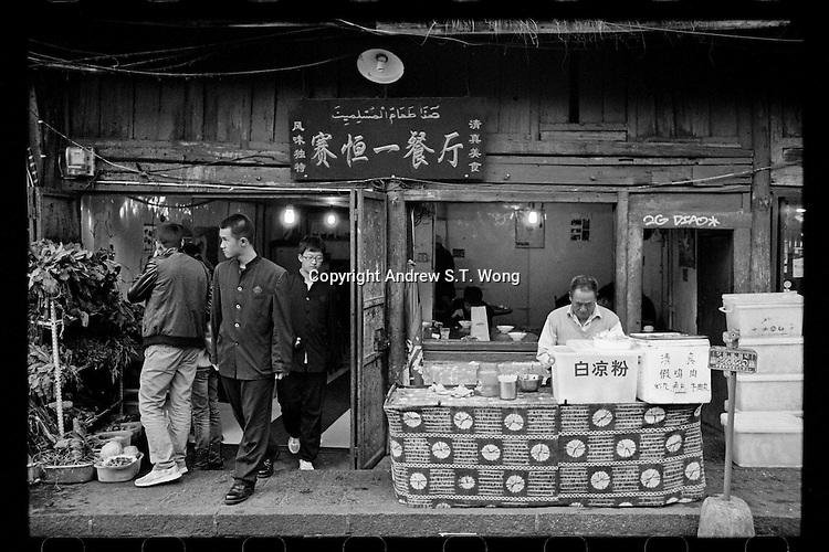 Students leave a local restaurant in the ancient city of Dali, Yunnan province, China, October 2013.