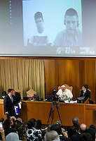 "Papa Francesco parla in interconnessione agli studenti di diversi paese durante l'udienza i partecipanti all'Incontro Mondiale dei Dirigenti di Scholas Occurentes, nell'Aula del Sinodo, Citta' del Vaticano, 4 settembre 2014.<br /> Pope Francis talks with students from different countries connected via Internet during his meeting with participants in the ""Scholas Occurentes"" executives world meeting, at the Vatican, 4 September 2014.<br /> UPDATE IMAGES PRESS/Riccardo De Luca<br /> <br /> STRICTLY ONLY FOR EDITORIAL USE"