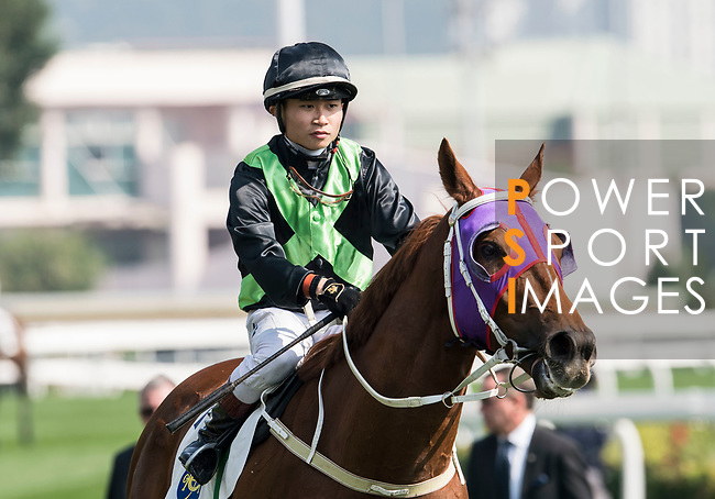 Jockey Dylan H T Mo riding Key Witness wins in the Race 2, Able Friend Handicap, during the Longines Hong Kong International Races at Sha Tin Racecourse on December 10 2017, in Hong Kong, Hong Kong. Photo by Victor Fraile / Power Sport Images