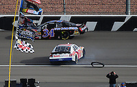 Feb. 28, 2009; Las Vegas, NV, USA; NASCAR Nationwide Series driver Carl Edwards spins after losing a tire during the Sam's Town 300 at Las Vegas Motor Speedway. Mandatory Credit: Mark J. Rebilas-
