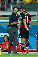 Germany manager Joachim Low shakes hands with Miroslav Klose of Germany