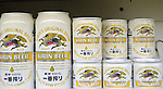 """Tokyo, Japan - Large and mini sizes of Kirin Beer are on the shelves at a supermarket in Tokyo. Chu-hi, which is a type of a alcoholic drink, is a favorite among many Japanese people. The name, """"Chu-hi"""" is a derived form of a combination of """"shochu and highball."""" Chu-hi companies often launch limited edition themed drinks to celebrate the different seasons in Japan. (Photo by Yumeto Yamazaki/AFLO)"""