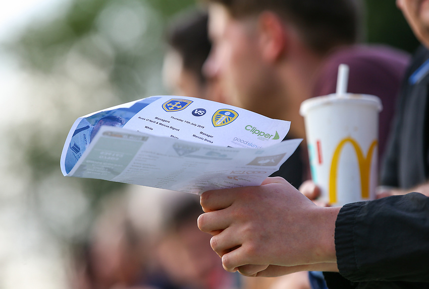 A fan holds a team sheet<br /> <br /> Photographer Alex Dodd/CameraSport<br /> <br /> Football Pre-Season Friendly - Guiseley v Leeds United - Thursday July 11th 2019 - Nethermoor Park - Guiseley<br /> <br /> World Copyright © 2019 CameraSport. All rights reserved. 43 Linden Ave. Countesthorpe. Leicester. England. LE8 5PG - Tel: +44 (0) 116 277 4147 - admin@camerasport.com - www.camerasport.com