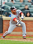 11 April 2012: Washington Nationals catcher Jesus Flores attempts a bunt during a game against the New York Mets at Citi Field in Flushing, New York. The Nationals shut out the Mets 4-0 to take the rubber match of their 3-game series. Mandatory Credit: Ed Wolfstein Photo