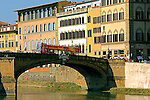"The partial view of  the busy  bridge  ""Ponte Santa Trinita' with beautiful Florentine architecture in the background."