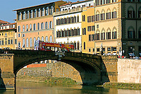 """The partial view of  the busy  bridge  """"Ponte Santa Trinita' with beautiful Florentine architecture in the background."""