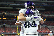 Indianapolis, IN - December 1, 2018: Northwestern Wildcats wide receiver Cameron Green (84) celebrates with a teammate after scoring a touchdown during the Big Ten championship game between Northwestern  and Ohio State at Lucas Oil Stadium in Indianapolis, IN.   (Photo by Elliott Brown/Media Images International)