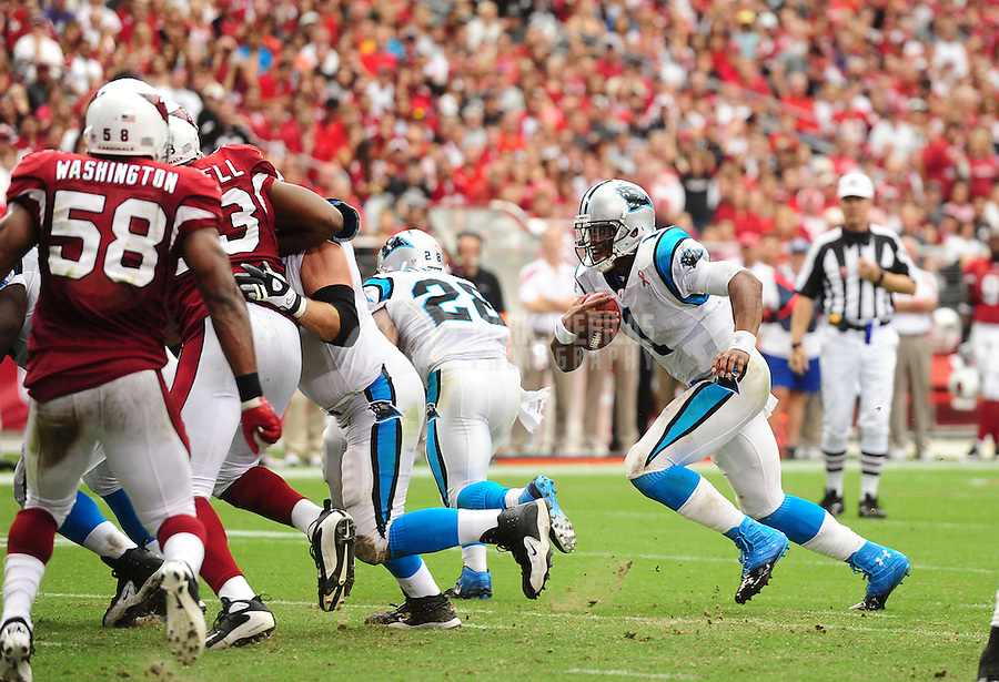 Sept. 11, 2011; Glendale, AZ, USA; Carolina Panthers quarterback (1) Cam Newton runs for his first career rushing touchdown against the Arizona Cardinals at University of Phoenix Stadium. The Cardinals defeated the Panthers 28-21. Mandatory Credit: Mark J. Rebilas-