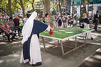 Nuns from the Sisters of Life order of the Catholic Church play an energetic game of table tennis in Bryant Park in New York on August 15, 2013. The sisters had the day off for the Assumption of the Virgin Mary holiday which coincidently occurs this year on National Relaxation Day.(© Richard B. Levine)