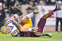 LSU wide receiver Trey Quinn (8) is brought down by Texas A&M defender short of a first down during an NCAA football game, Thursday, November 27, 2014 in College Station, Tex. (Mo Khursheed/TFV Media via AP Images)