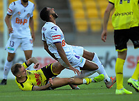Phoenix's David Ball fouls Perth's Gregory Wurthrich during the A-League football match between Wellington Phoenix and Perth Glory at Westpac Stadium in Wellington, New Zealand on Sunday, 27 October 2019. Photo: Dave Lintott / lintottphoto.co.nz