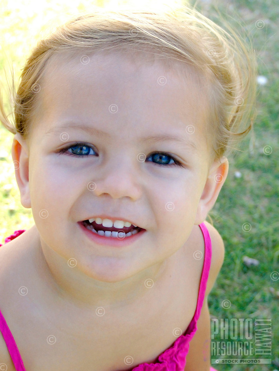 Close-up of smiling girl in pink