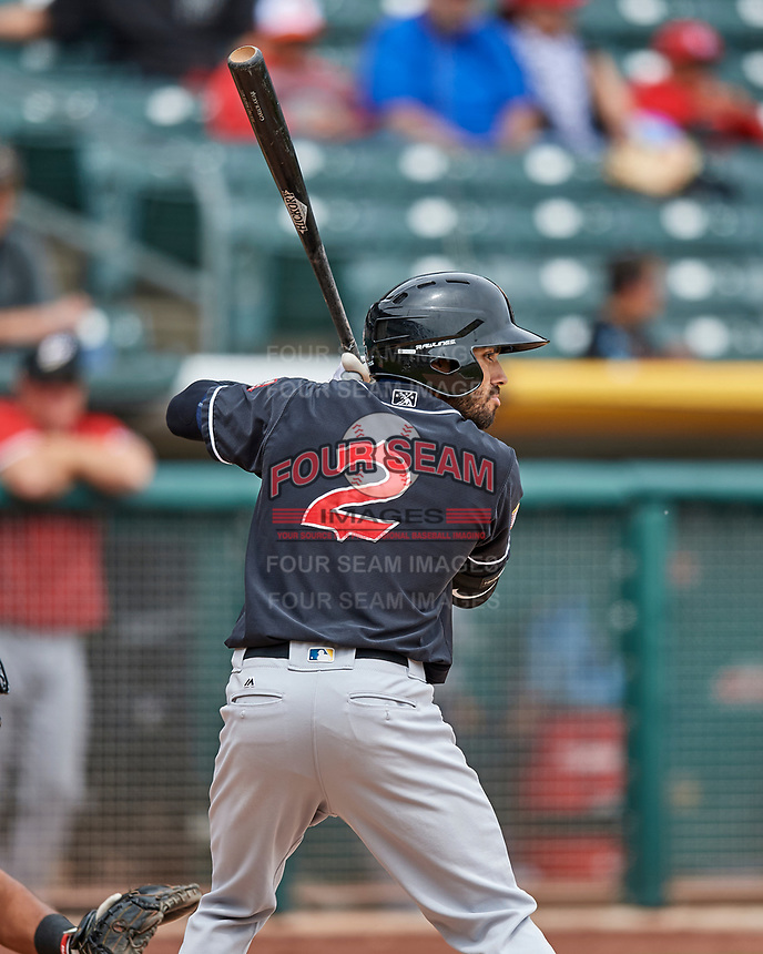 Carlos Asuaje (2) of the El Paso Chihuahuas at bat against the Salt Lake Bees in Pacific Coast League action at Smith's Ballpark on April 30, 2017 in Salt Lake City, Utah. El Paso defeated Salt Lake 3-0. This was Game 1 of a double-header. (Stephen Smith/Four Seam Images)
