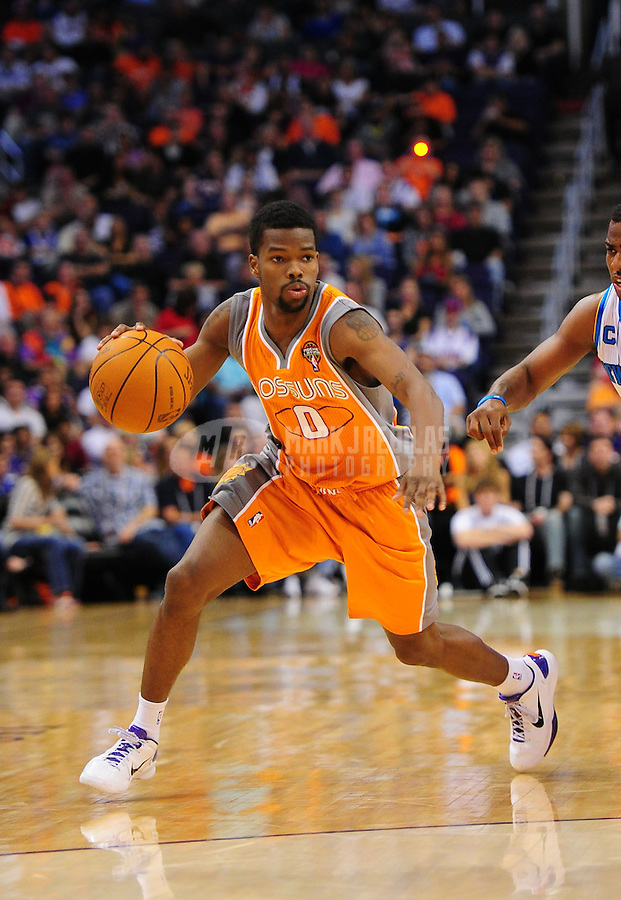 Mar. 25, 2011; Phoenix, AZ, USA; Phoenix Suns guard (0) Aaron Brooks drives to the basket in the second half against the New Orleans Hornets at the US Airways Center. The Hornets defeated the Suns 106-100. Mandatory Credit: Mark J. Rebilas-