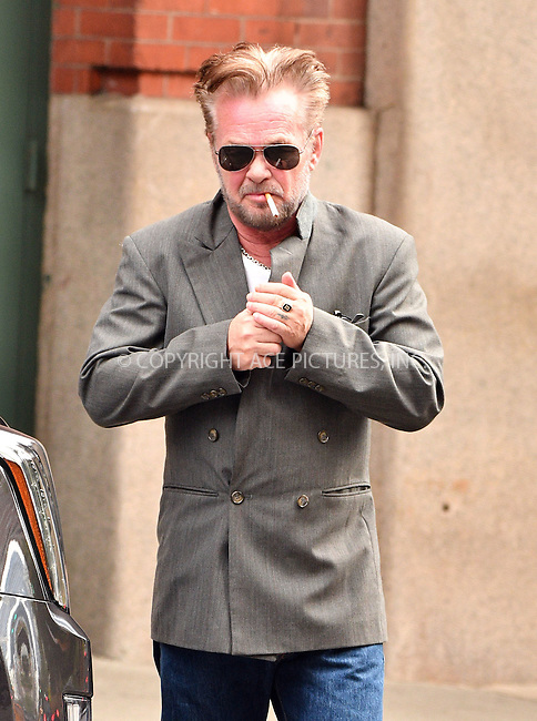 www.acepixs.com<br /> <br /> October 17 2016, New York City<br /> <br /> Musician John Mellencamp sparks up a cigarette as he leaves a downtown hotel on October 17 2016 in New York City<br /> <br /> By Line: Curtis Means/ACE Pictures<br /> <br /> <br /> ACE Pictures Inc<br /> Tel: 6467670430<br /> Email: info@acepixs.com<br /> www.acepixs.com