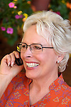 Mature woman talking on cell phone