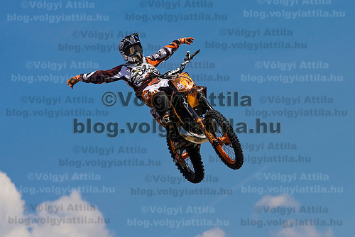 Alvaro Dal Farra from Italy performs during a freestyle motocross show organized by KTM in front of Arena Plaza, Budapest, Hungary. Thursday, 08. May 2008. ATTILA VOLGYI