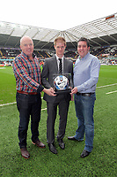 Pictured: Alan Tate (C) with match ball sponsors. Saturday 31 December 2011<br /> Re: Premier League football Swansea City FC v Tottenham Hotspur at the Liberty Stadium, south Wales.