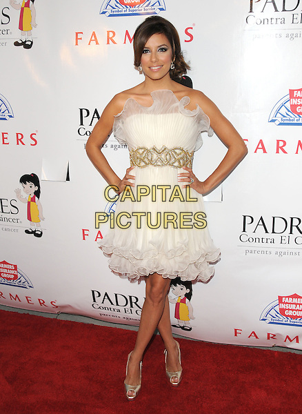 EVA LONGORIA PARKER.The Padres Contra El Cancer's 9th Annual El Sueno de Esperanza Gala held at The Palladium, Los Angeles, California, USA. .September 10th, 2009.full length strapless white cream dress gold waistband hands on hips shoes heels ruffle hem tulle platform.CAP/DVS.©Debbie VanStory/Capital Pictures.