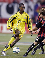The Crew's Edson Buddle looks to split the defense of Jeff Parke and Ricardo Clark of the MetroStars. The Columbus Crew and the MetroStars played to a 1-1 tie in regular season MLS action on Saturday October 9, 2004 at Giant's Stadium, East Rutherford, NJ..