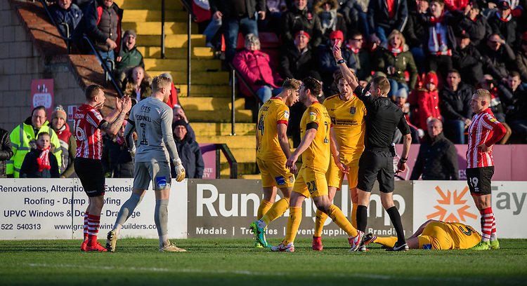 Lincoln City's Harry Anderson is shown a red card by referee Michael Salisbury<br /> <br /> Photographer Chris Vaughan/CameraSport<br /> <br /> The EFL Sky Bet League Two - Lincoln City v Northampton Town - Saturday 9th February 2019 - Sincil Bank - Lincoln<br /> <br /> World Copyright &copy; 2019 CameraSport. All rights reserved. 43 Linden Ave. Countesthorpe. Leicester. England. LE8 5PG - Tel: +44 (0) 116 277 4147 - admin@camerasport.com - www.camerasport.com
