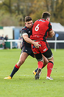 Ben Mosses of London Scottish tackles Langley of Hartpury RFC during the Greene King IPA Championship match between London Scottish Football Club and Hartpury RFC at Richmond Athletic Ground, Richmond, United Kingdom on 28 October 2017. Photo by David Horn.