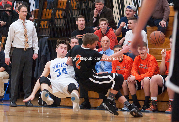 BURLINGTON, CT--- -030816JS04- Lewis Mills' Benjamin Lewis (34) and Watertown's Patrick Barber (2) both hit the floor after battling for a loose ball during their Class M first round game Tuesday at Lewis S. Mills High School in Burlington. <br /> Jim Shannon Republican-American