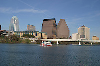 Cruise ship cruises up and down Lady Bird Lake on a beautiful sunny day in Austin, Texas